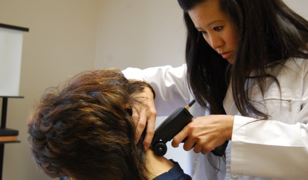 Titron unit being used by Dr. Stephanie Woo of Chiropractic Concept in Bellevue
